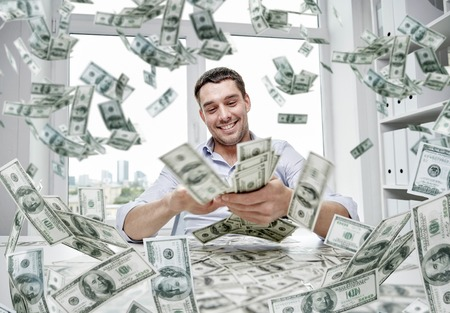 Foto de business, people, success and fortune concept - happy businessman with heap of dollar money at office - Imagen libre de derechos