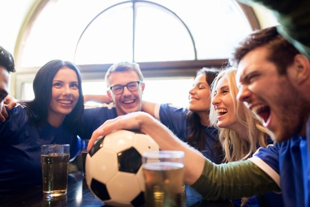 Photo for sport, people, leisure, friendship and entertainment concept - happy football fans or friends drinking beer and celebrating victory at bar or pub - Royalty Free Image