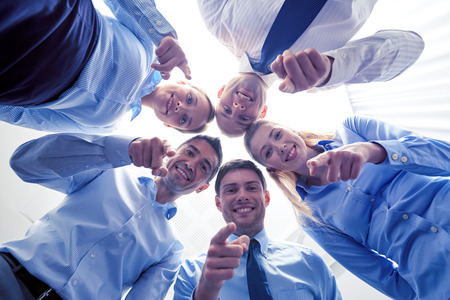Foto de business, people and teamwork concept - smiling group of businesspeople standing in circle - Imagen libre de derechos