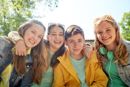 Photo for friendship and people concept - group of happy teenage students or friends outdoors - Royalty Free Image