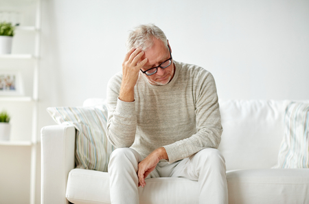 Photo pour health, pain, stress, old age and people concept - senior man suffering from headache at home - image libre de droit