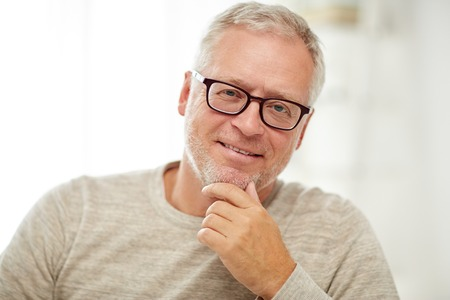 Photo pour old age, vision and people concept - close up of smiling senior man in glasses thinking - image libre de droit