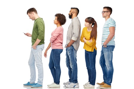Foto de technology, ethnicity and people concept - international group of men and women in queue line with smartphone over white - Imagen libre de derechos