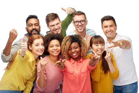 Foto de diversity, race, ethnicity and people concept - international group of happy smiling men and women showing thumbs up and peace over white - Imagen libre de derechos