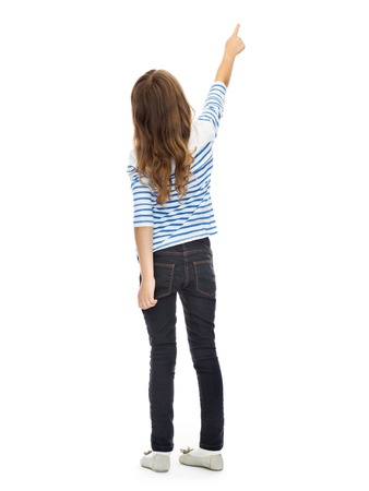 Photo pour education, people and childhood concept - girl pointing finger at something invisible over white - image libre de droit