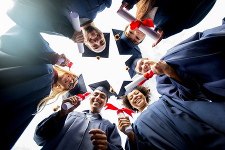 Photo pour education, graduation and people concept - group of happy international students in mortar boards and bachelor gowns standing in circle with diplomas - image libre de droit