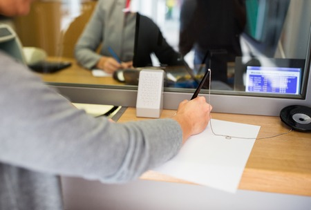 Photo pour people and finance concept - customer with pen and paper writing application at bank office - image libre de droit