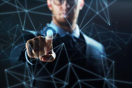 Photo pour businessman with virtual network hologram - image libre de droit