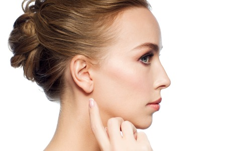 Photo for beautiful woman pointing finger to her ear - Royalty Free Image