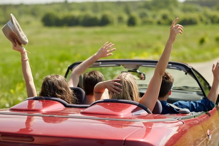 Photo pour happy friends driving in cabriolet car at country - image libre de droit