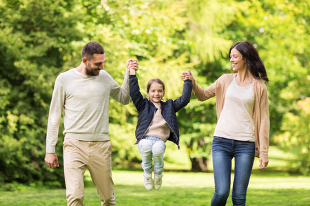 Photo for happy family walking in summer park and having fun - Royalty Free Image