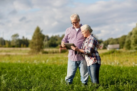 Photo for happy senior couple with tablet pc at summer farm - Royalty Free Image
