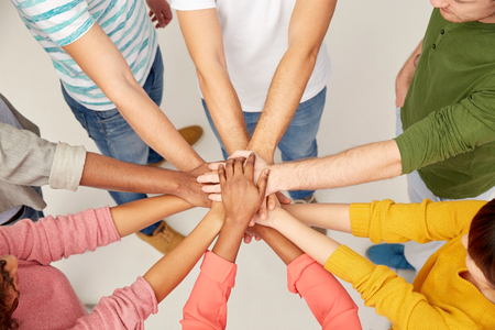 Photo for group of international people with hands together - Royalty Free Image
