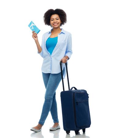 Photo pour happy woman with airplane ticket and travel bag - image libre de droit