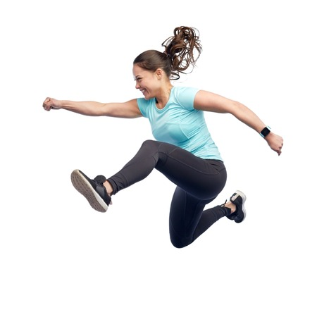 Photo pour happy smiling sporty young woman jumping in air - image libre de droit