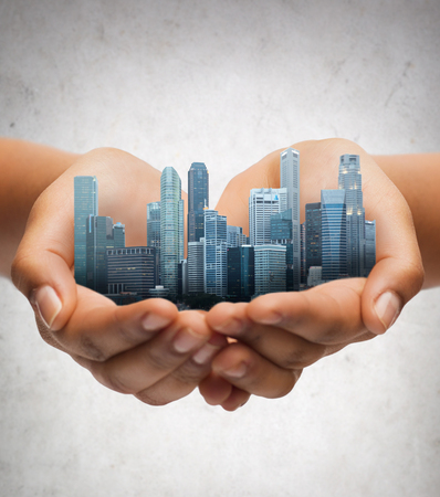 Photo for hands holding city over gray concrete background - Royalty Free Image