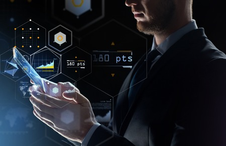 Photo pour business, people and future technology concept - close up of businessman with transparent tablet pc computer and virtual screen projection over black background - image libre de droit