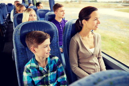 Foto per happy family riding in travel bus - Immagine Royalty Free