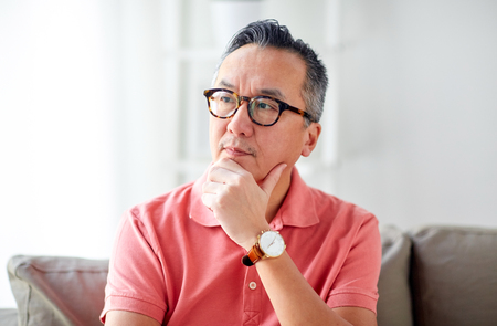 Photo for people concept - asian man thinking at home - Royalty Free Image
