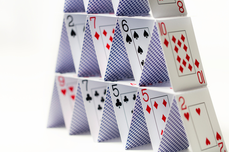 Photo pour house of playing cards over white background - image libre de droit