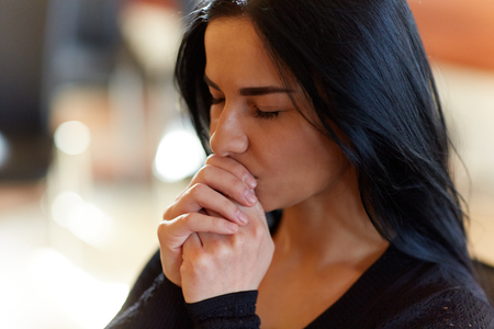 Photo pour burial, people and mourning concept - close up of unhappy woman praying god at funeral - image libre de droit
