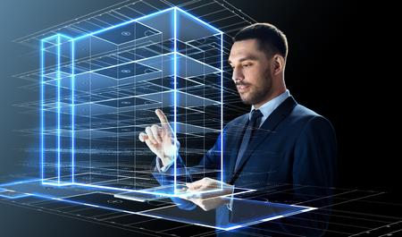 Photo pour businessman with tablet pc and building hologram - image libre de droit