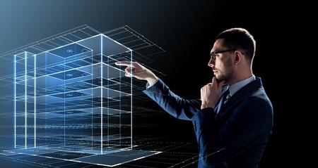 Foto de business, people and future technology concept - businessman in glasses with virtual construction hologram over black background - Imagen libre de derechos