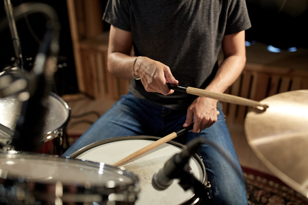 Photo for male musician playing drums and cymbals at concert - Royalty Free Image