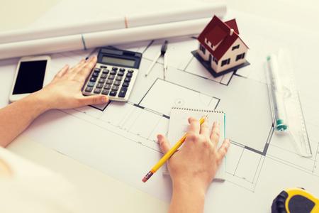 Foto de close up of architect hand counting on calculator - Imagen libre de derechos