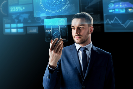 Photo pour business, augmented reality and future technology concept - businessman working with transparent smartphone and virtual screens projections over black background - image libre de droit