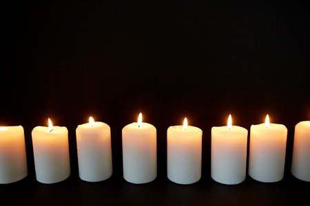 Photo for candles burning in darkness over black background - Royalty Free Image