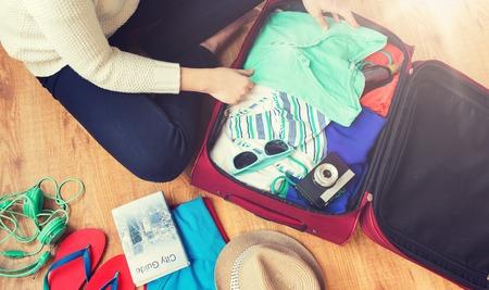Foto de close up of woman packing travel bag for vacation - Imagen libre de derechos