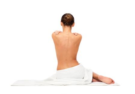 Foto de beautiful young woman in white towel with bare top - Imagen libre de derechos