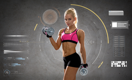 Photo pour fitness, sport, people and training concept - happy young sporty woman exercising with heavy steel dumbbells over gray concrete background - image libre de droit