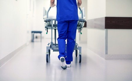 Photo pour people, healthcare, reanimation and medicine concept - nurse carrying hospital gurney to emergency room - image libre de droit