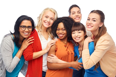 Photo pour diversity, race, ethnicity and people concept - international group of happy smiling different women over white hugging - image libre de droit