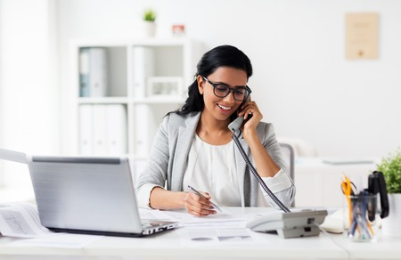 Photo pour business, technology, communication and people concept - happy smiling businesswoman with papers calling on phone at office - image libre de droit