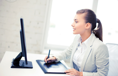 Photo for businesswoman with drawing tablet in office - Royalty Free Image
