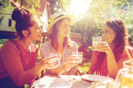 Photo for happy women with drinks at summer garden party - Royalty Free Image
