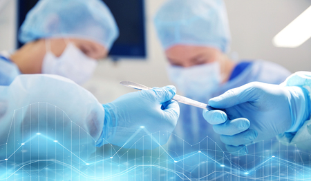 Photo pour close up of hands with scalpel at operation - image libre de droit