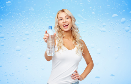 Photo for happy beautiful young woman with bottle of water - Royalty Free Image