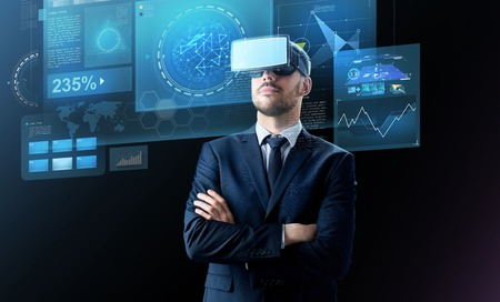Photo pour businessman in virtual reality headset over black - image libre de droit