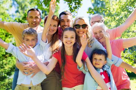 Photo pour happy family portrait in summer garden - image libre de droit