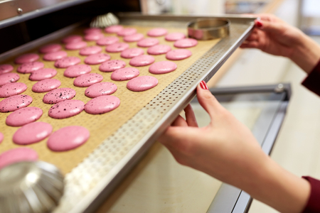 Photo for chef with macarons on oven tray at confectionery - Royalty Free Image