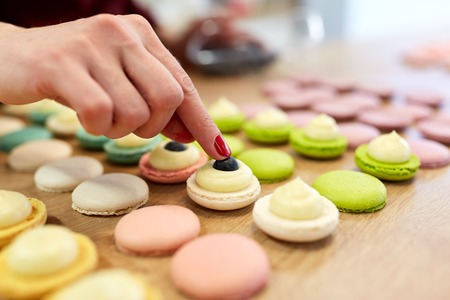 Photo for chef decorating macarons shells at pastry shop - Royalty Free Image