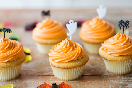 Photo for halloween party cupcakes or muffins on table - Royalty Free Image