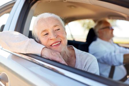 Foto de happy senior couple driving in car - Imagen libre de derechos