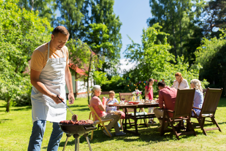 Photo pour man cooking meat on barbecue grill at summer party - image libre de droit