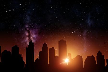 Photo pour futuristic city skyscrapers over sunrise in space - image libre de droit