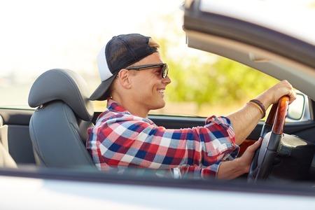 Foto de happy young man in shades driving convertible car - Imagen libre de derechos